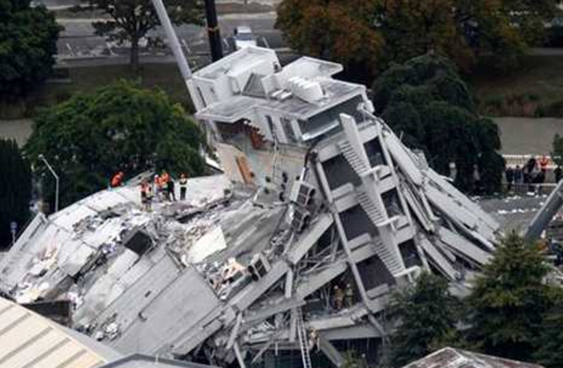Rescue workers climb onto collapsed building
