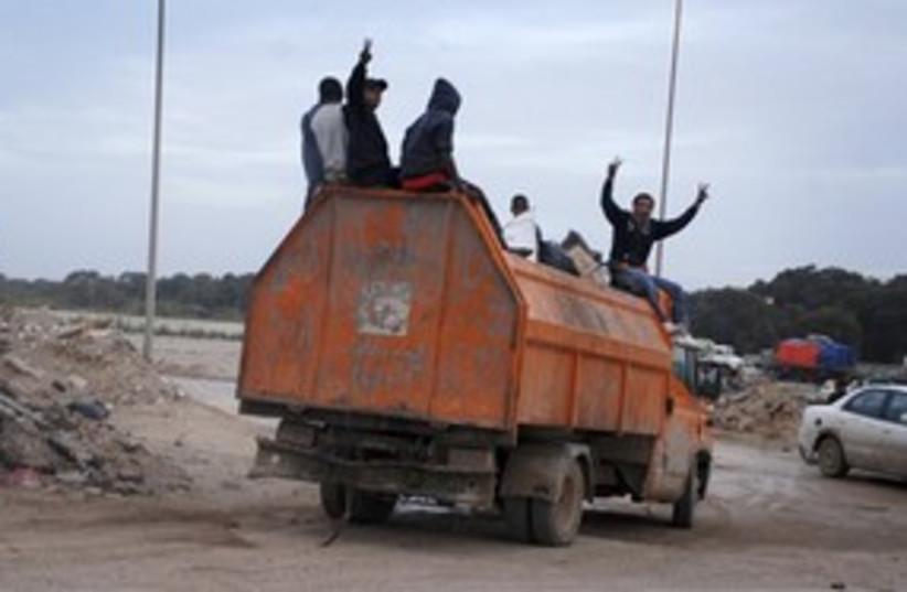 Libya protesters truck 311 AP (photo credit: Associated Press)