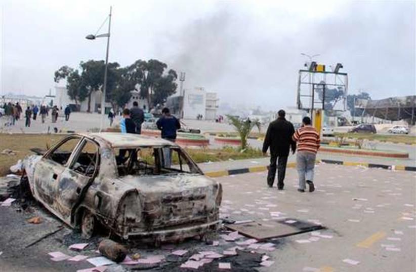 Libya  burnt  car 520 (photo credit: Associated Press)