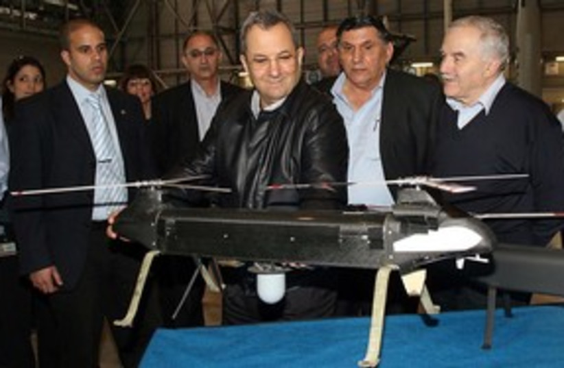 Barak at IAI with Ghost UAV drone 311 (photo credit: GIDEON MARKOWICZ)
