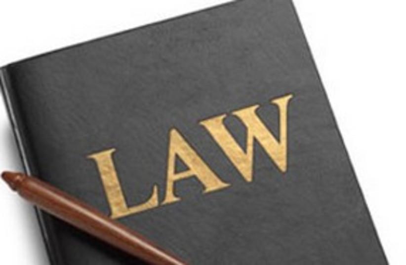 Law book gavel 311 (photo credit: AP)