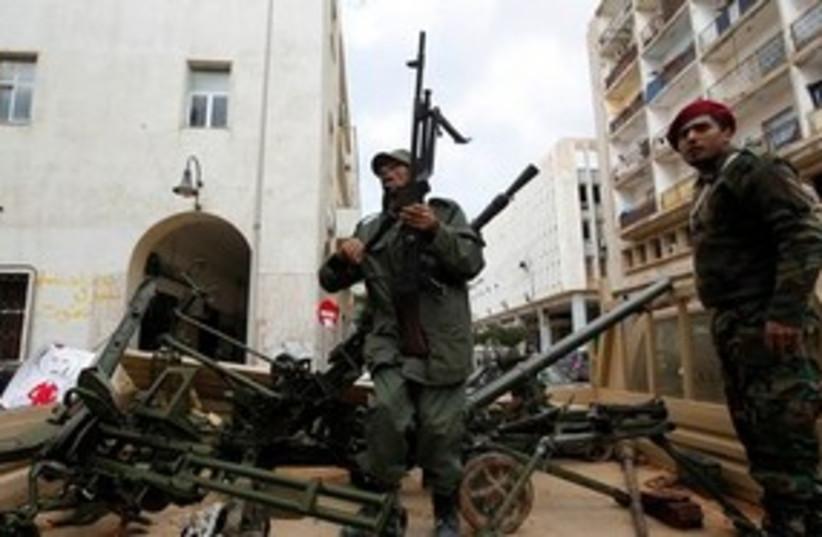 Anti-Gaddafi gunmen in Libya 311 AP (photo credit: AP)