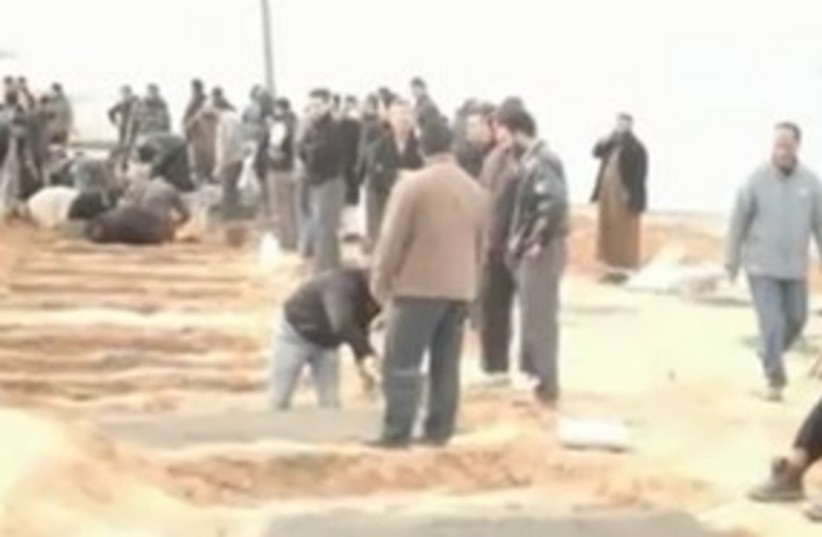 mass graves Libya_311 (photo credit: Still from video by OneDayOnEarth.org.)