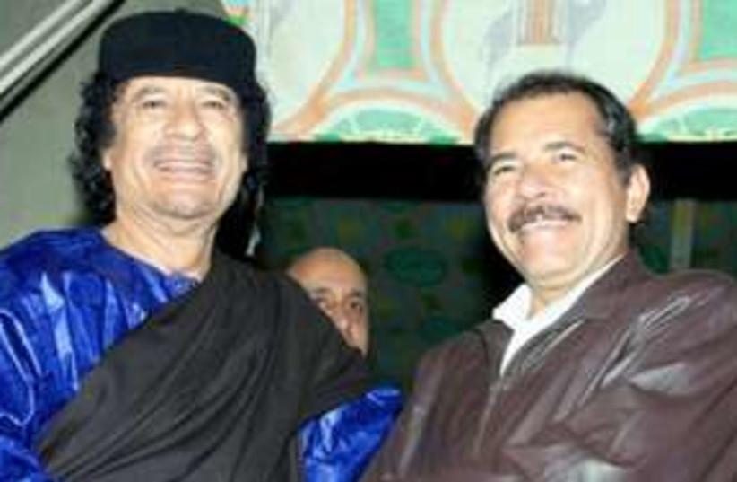 Nicaraguan President Daniel Ortega with Muammar Gaddafi 311  (photo credit: AP)