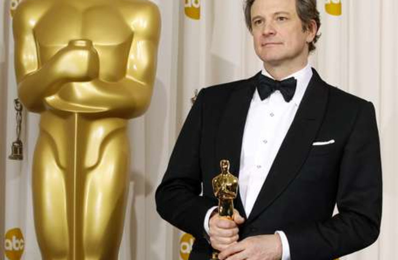 Colin Firth poses backstage with his Oscar