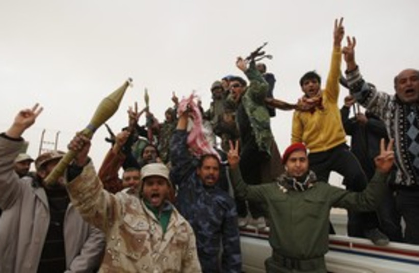Libya rebels waiting for a fight 311 Reu (photo credit: Asmaa Waguih / Reuters)
