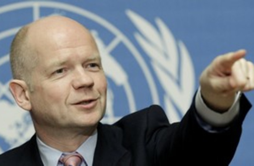 William Hague (R) 311 (photo credit: REUTERS/Denis Balibouse)