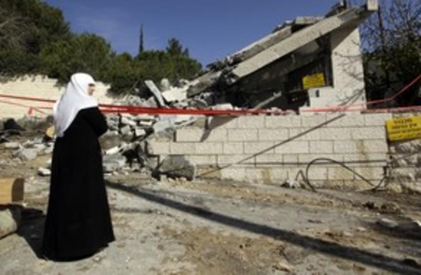House demoltion in east Jerusalem (R) 311 (photo credit: Reuters)