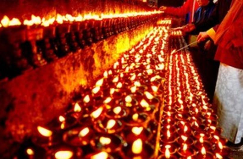 yak butter burning lamps (photo credit: Courtesy)