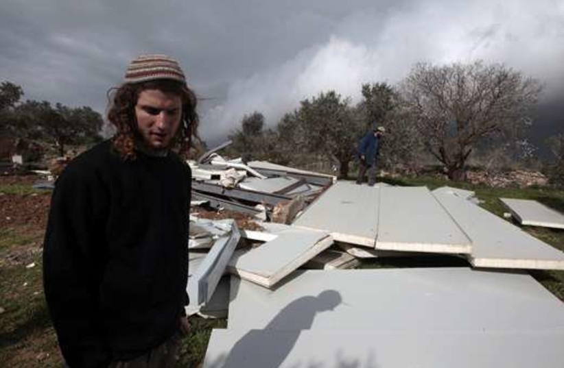 Settler in Havat Gilad 520 (photo credit: REUTERS/Baz Ratner)