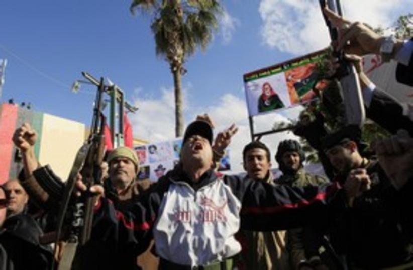 Libyan anti-Gaddafi protests (R) 311 (photo credit: REUTERS/Ahmed Jadallah)