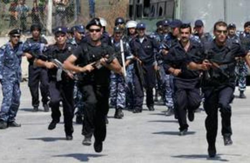 PA police training in Hebron 311 Reu (photo credit: Nayef Hashlamoun / Reuters)