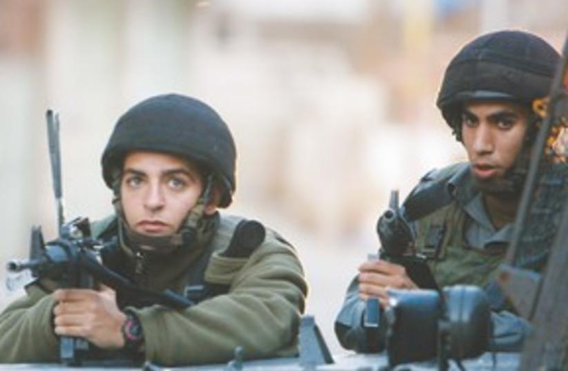 IDF soldiers  (R) 311 (photo credit: Reuters)