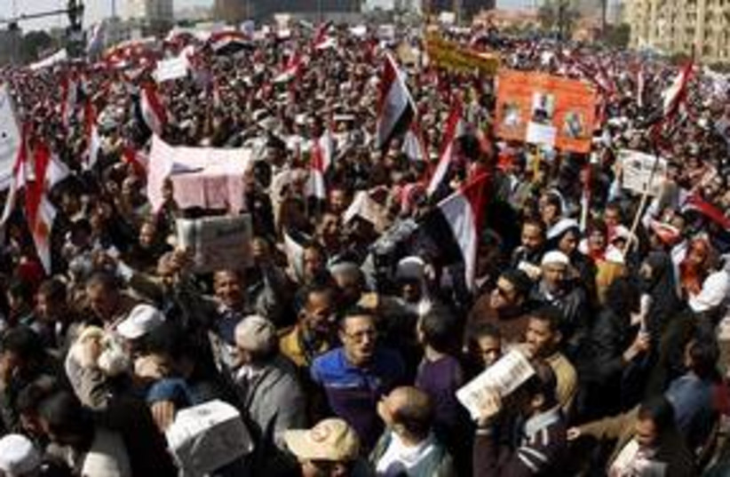 Pro-democracy protesters gather in Tahrir Square 311 Reut (photo credit: Peter Andrews / Reuters)