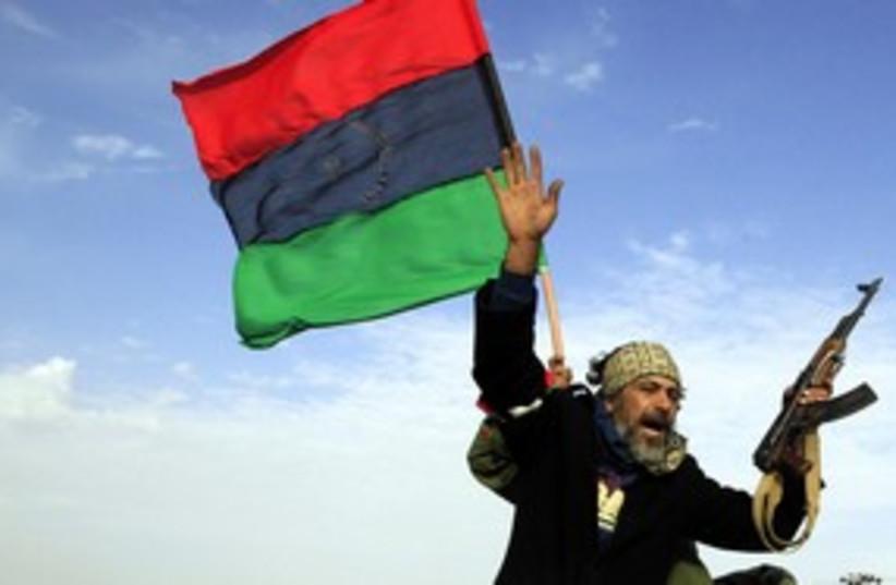 Libyan rebel waving hand (R) 311 (photo credit: REUTERS/Goran Tomasevic)