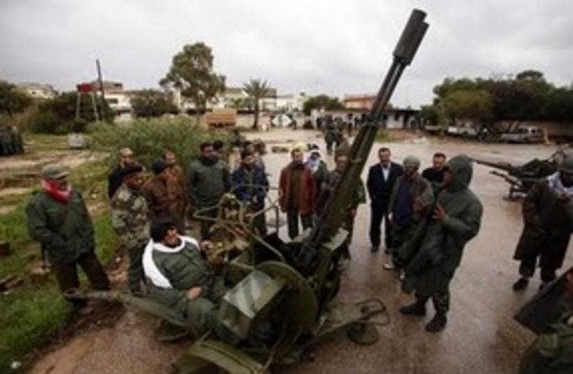 Libyan rebels using anti-aircraft gun 311 R (photo credit: Reuters)