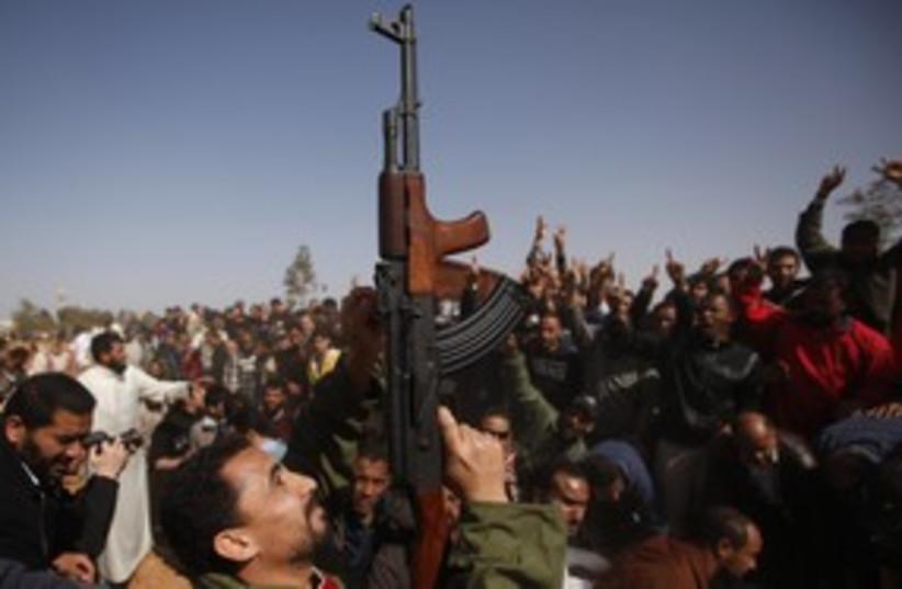Libya Rebel with Gun (R) 311 (photo credit: REUTERS/Suhaib Salem)