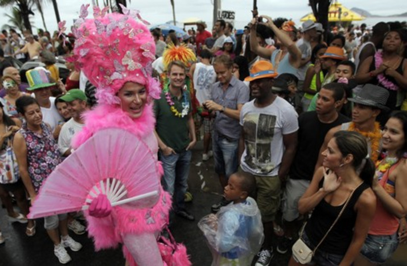 Revellers participate in an annual block party