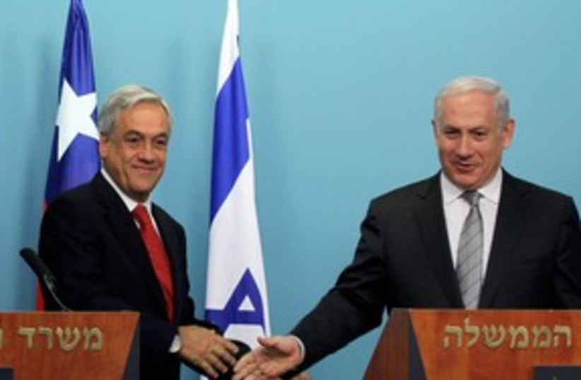 PM with Chilean Pres. Pinera 311 (photo credit: Marc Sellem)