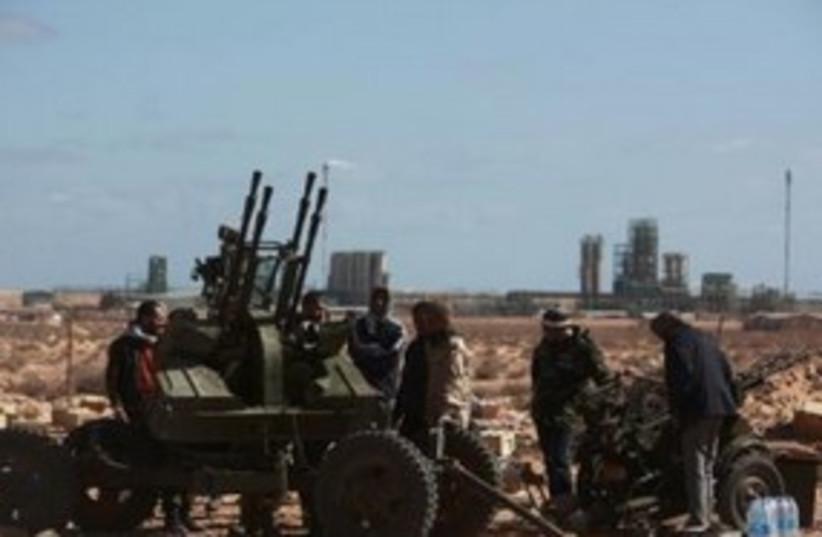 Libya rebels 311 Reuters  (photo credit: REUTERS/Asmaa Waguih)