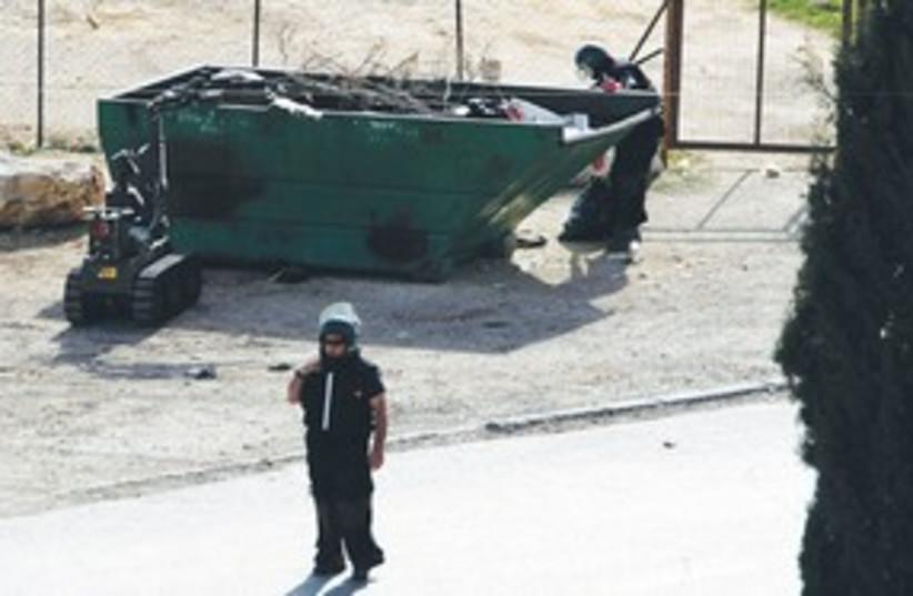Police sappers inspecting trash dumpster 311 Reu (photo credit: Baz Ratner/Reuters)