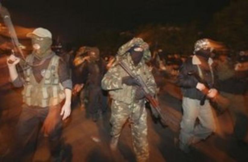 Armed Hamas members celebrate Mubarak resignation 311 R (photo credit: REUTERS/Mohammed Salem)