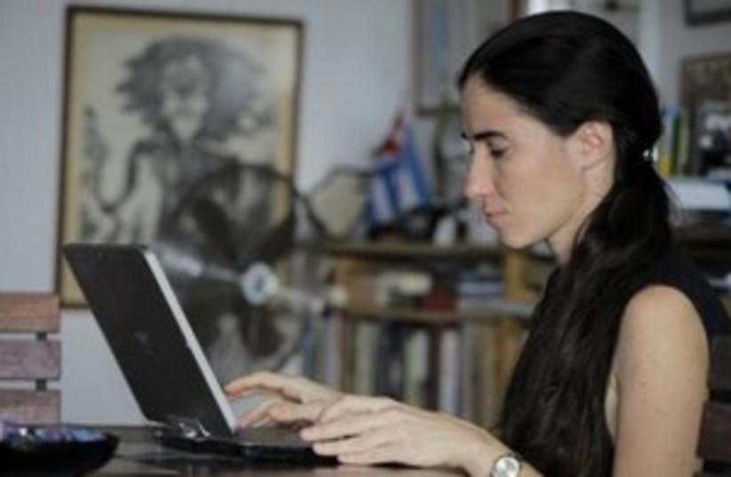 woman on laptop (photo credit: REUTERS/Desmond Boylan)