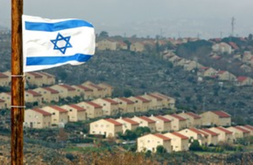 Israeli flag flutters over settlement of Ofra 311 R (photo credit: Laszlo Balogh / Reuters)