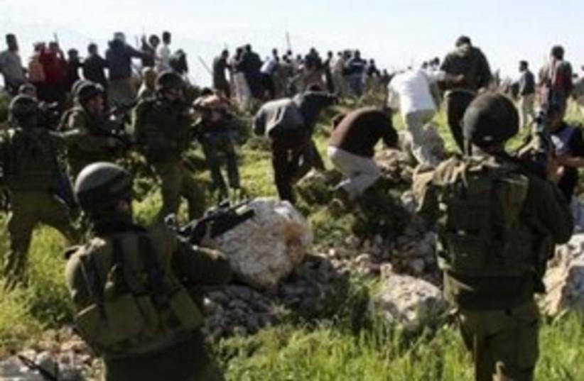 Clashes settlers Palestinians IDF soldiers 311 R (photo credit: Reuters/Nayef Hashlamoun)