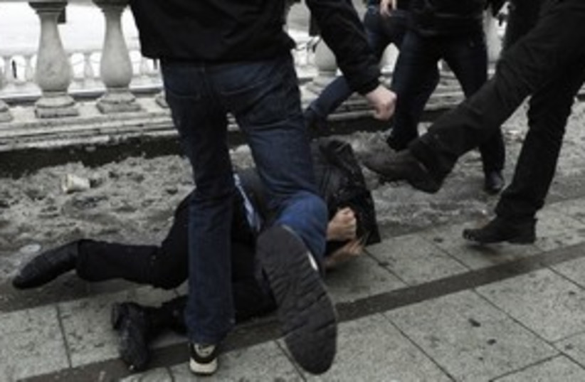 Xenophobia - man getting beaten kicked 311 R (photo credit: REUTERS)