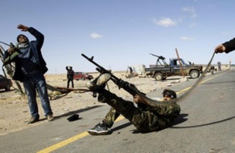 Libyan rebel firing at heli (R) 311 (photo credit: Goran Tomasevic / Reuters)