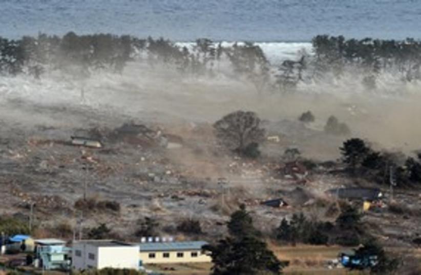 tsunami hits Japan_311 reuters (photo credit: KYODO Kyodo / Reuters)
