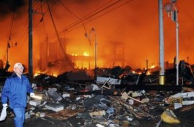 Flattened, burning homes after earthquake in Japan 311 R (photo credit: REUTERS/Kyodo)