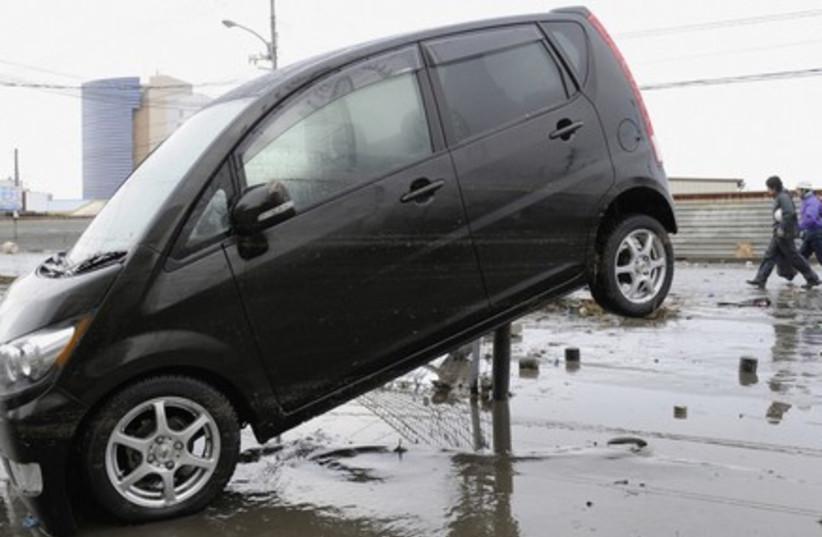 A car propped up on a pole