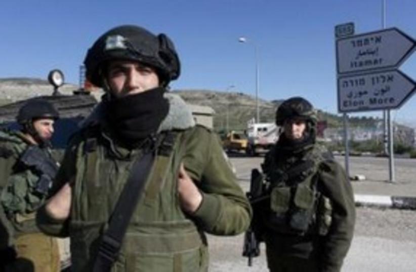 Soldiers at Itamar settlement 311 (photo credit: REUTERS/Nir Elias)
