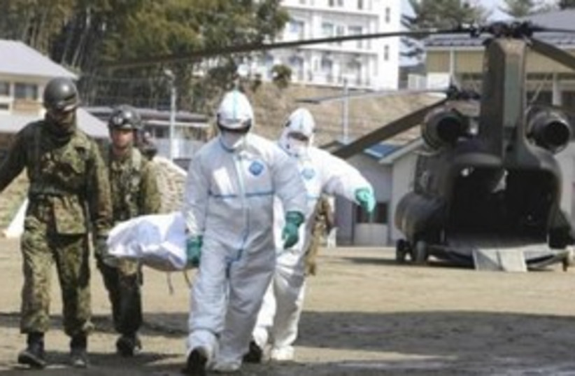Japanese victime suspected of radiation exposure 311 R (photo credit: REUTERS/Yomiuri Shimbun)