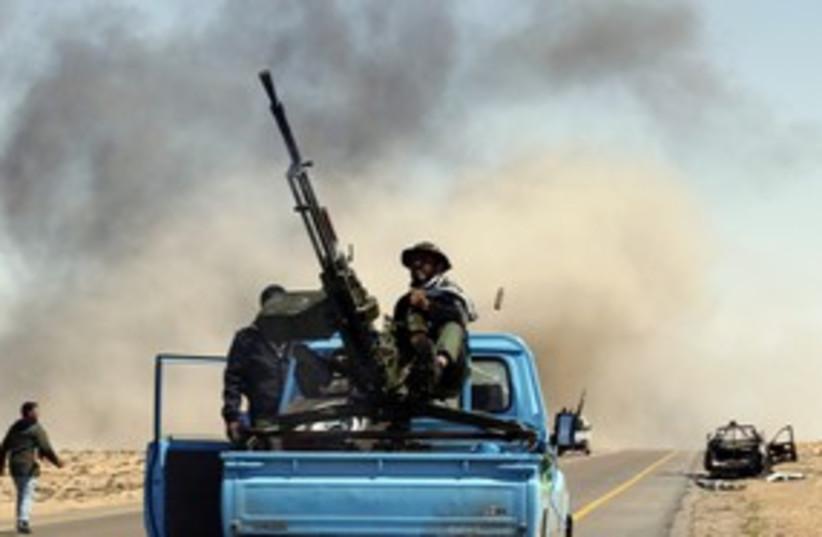 brega fighting in libya_311 reuters (photo credit: Goran Tomasevic / Reuters)
