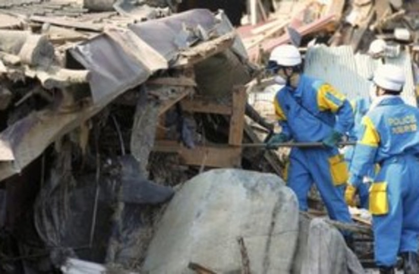Rescue workers searching through rubble in Japan 311 R (photo credit: REUTERS/Lee Jae-Won)