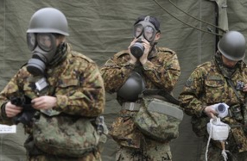 Japan Self-Defense Force officers (R) 311 (photo credit: REUTERS/KYODO Kyodo)