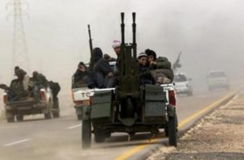 Libyan rebels fleeing 311 (R) (photo credit: REUTERS/Goran Tomasevic)
