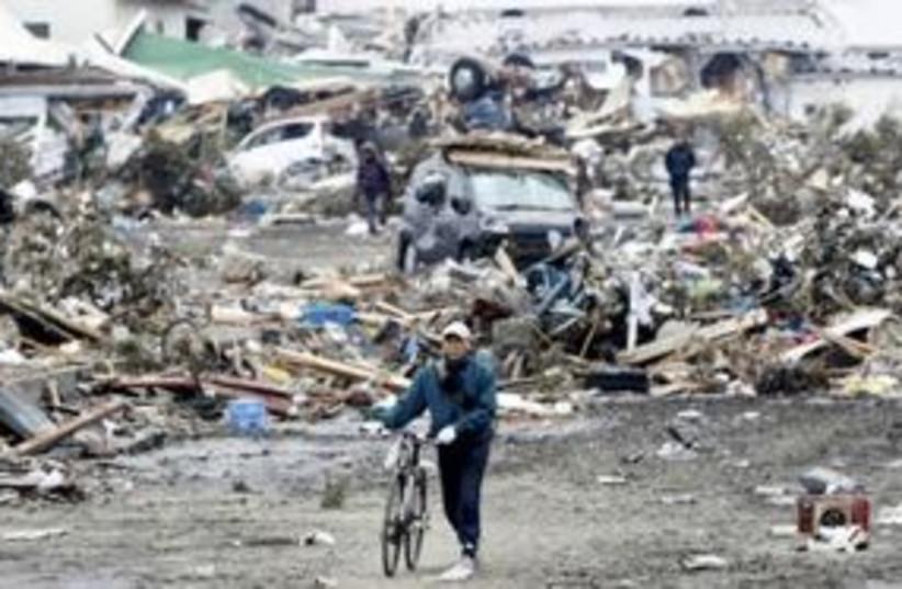 Japan bicycle destruction 311 (R) (photo credit: REUTERS/Jo Yong-Hak)