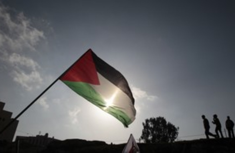 Palestinian Flag 311 (photo credit: REUTERS)