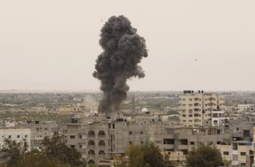 IAF airstrike Gaza_311 reuters (photo credit: Ibraheem Abu Mustafa / Reuters)