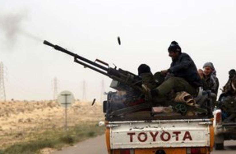 Libya rebels benghazi_311 reuters (photo credit: Goran Tomasevic / Reuters)