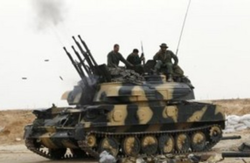 Libyan Soldiers Tank 311 (R) (photo credit: REUTERS)