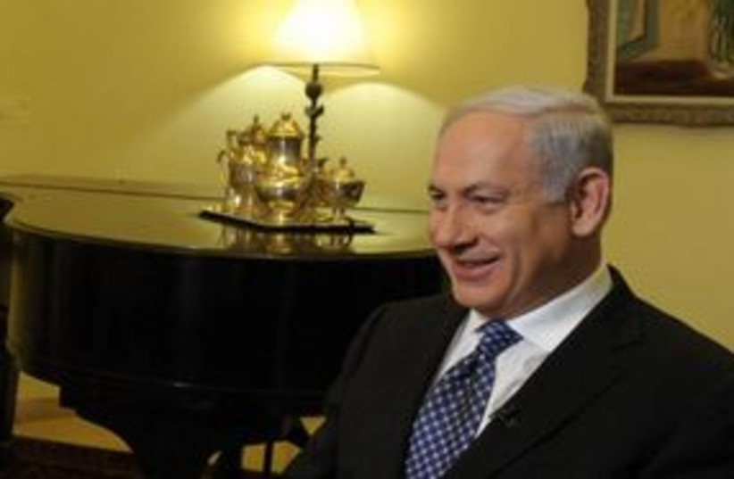 Netanyahu smiling 311 (photo credit: Amos Ben Gershom/GPO)