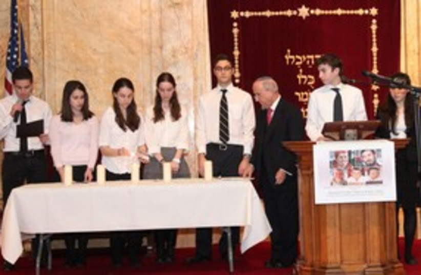 Rabbi Haskel Lookstein and students light candles 311 (photo credit: Courtesy Council of Presidents)