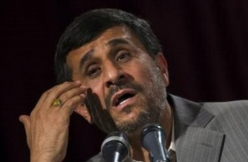 Iranian President Mahmoud Ahmadinejad 311 (R) (photo credit: REUTERS/Morteza Nikoubazl)