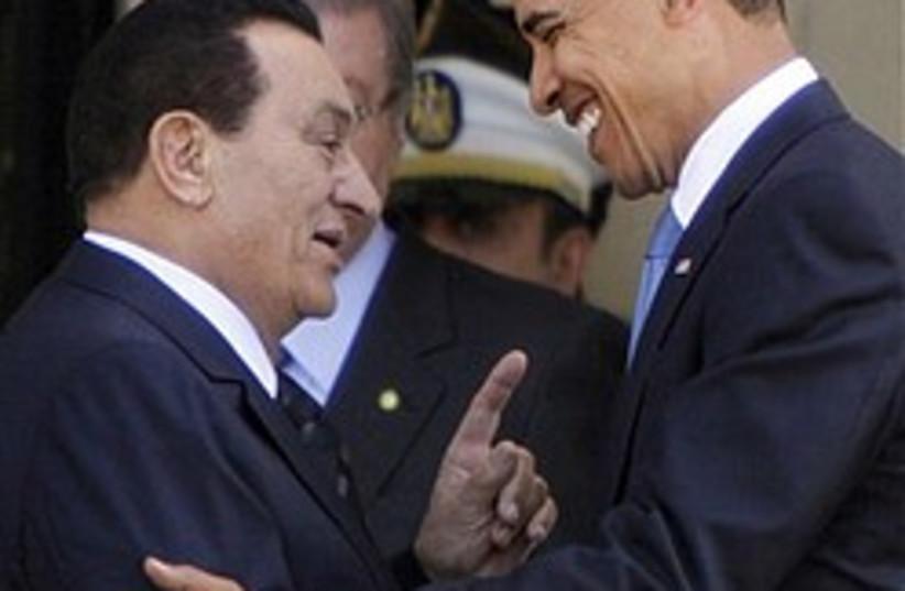 Egyptian President Hosni Mubarak talks to US Presi (photo credit: AP)