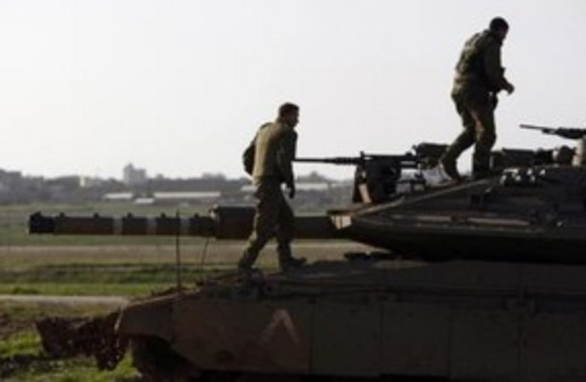 IDF soldiers on tank near Gaza border 311 (R) (photo credit: REUTERS/Amir Cohen)